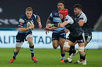 Gareth Anscombe of the Cardiff Blues (L) is marked by Sam Cross of the Ospreys (R) during the Guinness Pro14 match between the Ospreys and Cardiff Blues at the Liberty Stadium, Swansea, Wales, UK. Saturday 05 January 2018