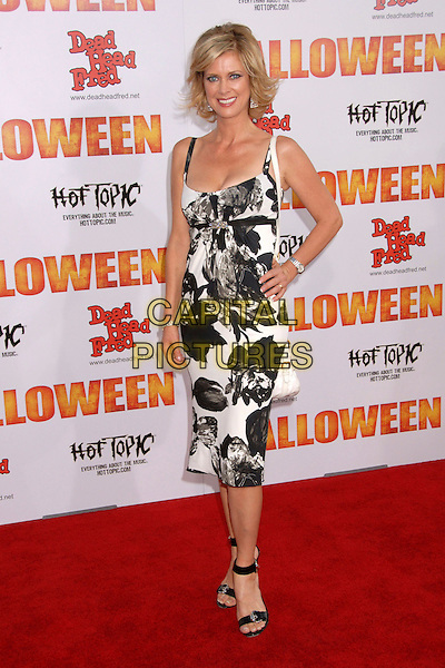 """ANITA SEELIG.""""Halloween"""" World Premiere at Grauman's Chinese Theatre, Hollywood, California, USA..August 23rd, 2007.full length black white floral print pattern dress hand on hip .CAP/ADM/BP.©Byron Purvis/AdMedia/Capital Pictures"""