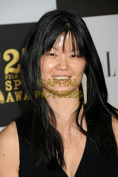 KARIN CHEIN .25th Annual Film Independent Spirit Awards - Arrivals held at the Nokia Event Deck at L.A. Live, Los Angeles, CA, USA, 5th March 2010..indie arrivals portrait headshot black fringe smiling .CAP/ADM/BP.©Byron Purvis/AdMedia/Capital Pictures.