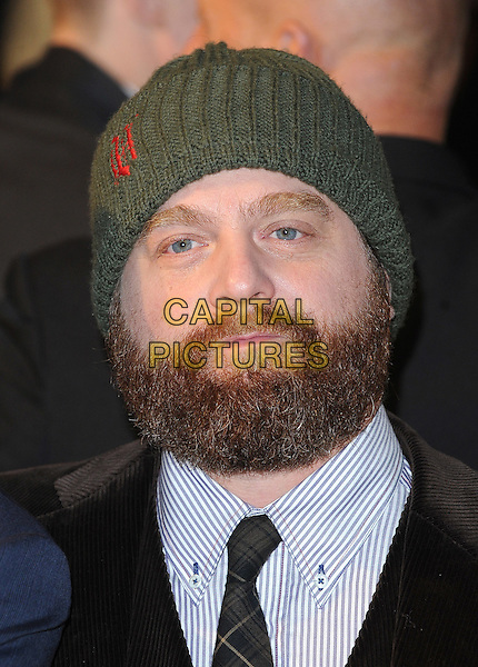 ZACH GALIFIANAKI.'Due Date' UK film premiere at the Empire cinema, Leicester Square, London, England, UK,.3rd November 2010..portrait headshot green knitted beanie hat poppy black tie plaid .CAP/BEL.©Tom Belcher/Capital Pictures.