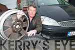 DAMAGE: Tralee Taxi operator Liam Duffy with the wheel which was damaged when his car hit a pot hole near the Ferry Bridge in North Kerry on Monday night.   Copyright Kerry's Eye 2008