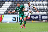 Connor Wickham of Sheffield Wednesday battles with Jake Bidwell of Swansea City during the Sky Bet Championship match between Swansea City and Sheffield Wednesday at the Liberty Stadium in Swansea, Wales, UK. Sunday 05 July 2020