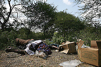 a fallen United Islamic Courts milita gun man lies next to a carton of Saudi dates on a battle field  between Buur Hakaba  and Baidoa, Somalia on Thursday Dec 28 2006..