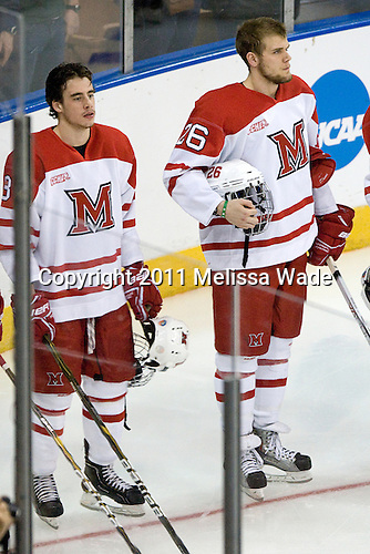 Reilly Smith (Miami - 18), Joe Hartman (Miami - 26) - The University of New Hampshire Wildcats defeated the Miami University RedHawks 3-1 (EN) in their NCAA Northeast Regional Semi-Final on Saturday, March 26, 2011, at Verizon Wireless Arena in Manchester, New Hampshire.