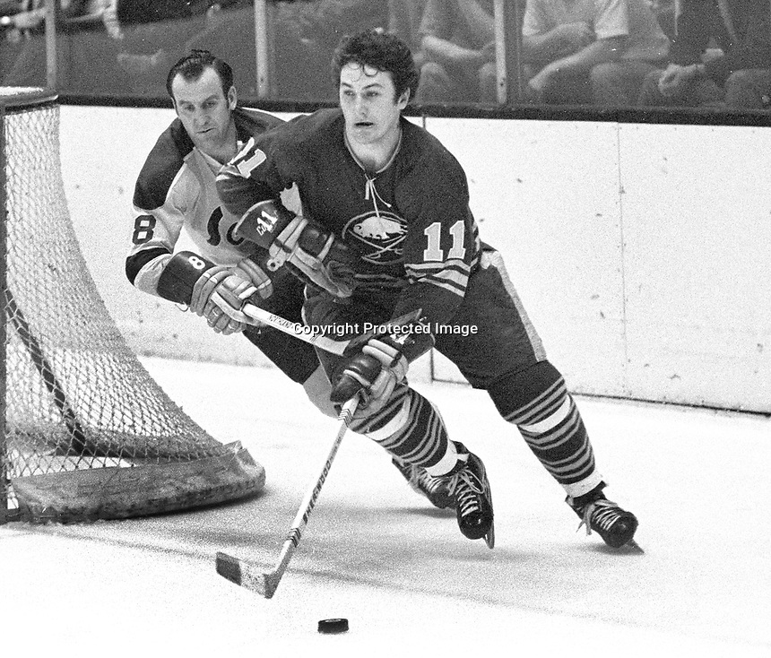 Buffalo Sabre Gilbert Perreault and Seals Gerry Ehman...(1971 photo/Ron Riesterer)