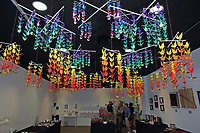New York, NY, USA - June 24-25, 2017: OrigamiUSA 2017 Convention at St. John's University, Queens, New York, USA. Exhibition of origami in the Sun Yat Sen Memorial building. 1000 Cranes suspended from the ceiling, folded by Ruthanne Bessman.