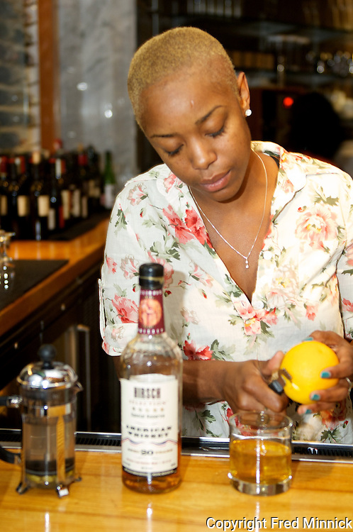 Tiffanie Barriere is the mixologist for the One Flew South restaurant in the Atlanta Airport.