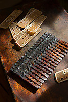 Leather scales for a set of armour. Robert Soanes Japanese Armour and Antiques Restorer, Brighton, UK, May 6, 2016. Craftsman Robert Soanes specializes in the restoration and conservation of samurai armour, swords and other Japanese fine art. He lives and works in the English seaside resort of Brighton.