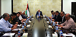 Palestinian Prime Minister Rami Hamdallah chairs a meeting with security chiefs at his office, in the West Bank city of Ramallah on July 18, 2017. Photo by Prime Minister Office