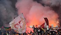 FUSSBALL  CHAMPIONS LEAGUE  ACHTELFINALE  HINSPIEL  2012/2013      FC Arsenal London - FC Bayern Muenchen       19.02.2013 Bayern Fans brennen Pyrotechnik in ihrem Fanblock ab