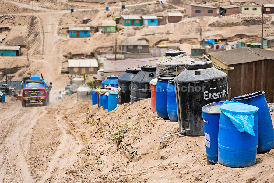 Plastic barrels and water tanks, used for water storage, are seen along the sandy path on the dusty hillside of Pachacútec, a desert suburb of Lima, Peru, 24 January 2015. Although Latin America (as a whole) is blessed with an abundance of fresh water, having 20% of global water resources in the the Amazon Basin and the highest annual rainfall of any region in the world, an estimated 50-70 million Latin Americans (one-tenth of the continent's population) lack access to safe water and 100 million people have no access to any safe sanitation. Complicated geographical conditions (mainly on the Pacific coast), unregulated industrialization (causing environmental pollution) and massive urban poverty, combined with deep social inequality, have caused a severe water supply shortage in many Latin American regions.