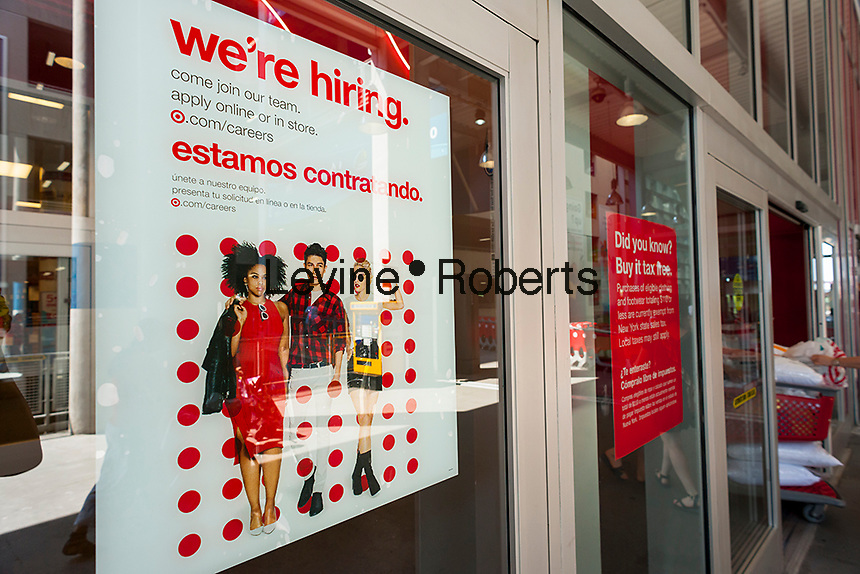 A hiring sign in English and Spanish at the entrance of a Target store in East Harlem in New York on Monday, June 12, 2017 informs prospective employees of the opportunities awaiting them in retail.. (© Richard B. Levine)