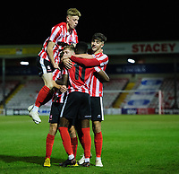 Lincoln City U18's Jordan Adebayo-Smith celebrates scoring his side's third goal with team-mates<br /> <br /> Photographer Chris Vaughan/CameraSport<br /> <br /> The FA Youth Cup Second Round - Lincoln City U18 v South Shields U18 - Tuesday 13th November 2018 - Sincil Bank - Lincoln<br />  <br /> World Copyright © 2018 CameraSport. All rights reserved. 43 Linden Ave. Countesthorpe. Leicester. England. LE8 5PG - Tel: +44 (0) 116 277 4147 - admin@camerasport.com - www.camerasport.com
