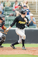 Erich Weiss (22) of the West Virginia Power follows through on his swing against the Kannapolis Intimidators at CMC-Northeast Stadium on April 30, 2014 in Kannapolis, North Carolina.  The Intimidators defeated the Power 2-1 in game one of a double-header.  (Brian Westerholt/Four Seam Images)