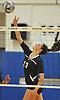 Massapequa No. 13 Mackenzie Byrne tips a ball over the net during a Nassau County varsity girls' volleyball match against host Plainview JFK High School on Monday, October 19, 2015. Massapequa won 25-16, 25-8, 25-13.<br /> <br /> James Escher