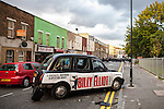 © Joel Goodman - 07973 332324 . 08/08/2011 . London , UK . A smashed up black taxi on Clarence Road on the Pembury Estate in Hackney during a 3rd night of rioting and looting in London , which followed a protest against the police shooting of Mark Duggan in Tottenham . Photo credit : Joel Goodman