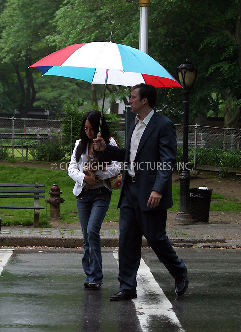 "***EXCLUSIVE*** Actor Nicolas Cage and his girlfriend Alice Kim take a stroll in a rainy Central Park during a break in filming of Cage's new movie ""The Weatherman"". New York City. May 19 2004. Please byline: BRIAN FLANNERY/ ACE Pictures.   ..*PAY-PER-USE*      ....IMPORTANT: Please note that our old trade name, NEW YORK PHOTO PRESS (NYPP), is replaced by our new name, ACE PICTURES. New York Photo Press and ACE Pictures are owned by All Celebrity Entertainment, Inc.......All Celebrity Entertainment, Inc:  ..contact: Alecsey Boldeskul (646) 267-6913 ..Philip Vaughan (646) 769-0430..e-mail: info@nyphotopress.com"