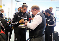 Wednesday 07 August 2013<br /> Pictured: Chico Flores signing an autograph for a fan at Cardiff Airport.  <br /> Re: Swansea City FC travelling to Sweden for their Europa League 3rd Qualifying Round, Second Leg game against Malmo.