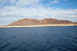 Agujas Grandes volcano, La Isla Graciosa from El Rio channel, Lanzarote, Canary Islands, Spain