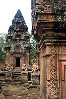 Statues of guardians stand on Banteay Srei temple, in Ankgor, Cambodia, on October 5, 2009. Banteay Srei (or Banteay Srey, meaning Citadel of women)  is a 10th century Cambodian temple, built largely of red sandstone, and dedicated to the Hindu god Shiva. Angkor used to be the seat of the Khmer empire, which flourished from approximately the ninth century to the thirteenth century. The ruins of Angkor temples are a UNESCO World Heritage Site. Photo by Lucas Schifres/Pictobank