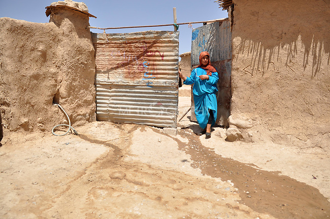 DOWDA, IRAQ:  A Kurdish woman walks out of her compound...Iraqi forces decimated the Dowda area in Germian during the 1988 Anfal genocidal campaign against the Kurds.  Daily life continues is this extremely harsh part of Iraq...Photo by Aram Karim/Metrography