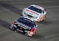 Nov. 15, 2008; Homestead, FL, USA; NASCAR Nationwide Series driver Kyle Busch (18) leads Carl Edwards (60) during the Ford 300 at Homestead Miami Speedway. Mandatory Credit: Mark J. Rebilas-