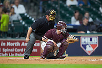 Mississippi State Bulldogs catcher Dustin Skelton (8) sets a target as home plate umpire John Schiller looks on during the game against the Louisiana Ragin' Cajuns in game three of the 2018 Shriners Hospitals for Children College Classic at Minute Maid Park on March 2, 2018 in Houston, Texas.  The Bulldogs defeated the Ragin' Cajuns 3-1.   (Brian Westerholt/Four Seam Images)