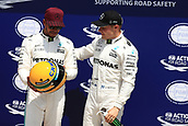 June 10th 2017, Circuit Gilles Villeneuve, Montreal Quebec, Canada; Formula One Grand Prix, Qualifying sessions; Lewis Hamilton - Mercedes AMG Petronas F1 W08 takes pole and  and is presented with a hisoric Senna helmet by his family with Valtteri Bottas