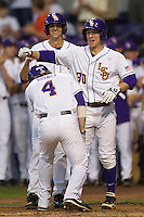 LSU Tigers shortstop Alex Bregman #30 celebrates with teammate Raph Rhymes #4 after his first inning home run against thea Auburn Tigers in the NCAA baseball game on March 22nd, 2013 at Alex Box Stadium in Baton Rouge, Louisiana. LSU defeated Auburn 9-4. (Andrew Woolley/Four Seam Images).