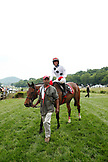 USA, Tennessee, Nashville, Iroquois Steeplechase, trainer walks Arcadia and jockey Brian Crowley following their win