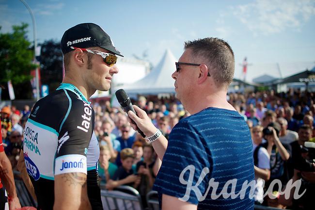 Tom Boonen (BEL/OPQS) interviewed by Carl Berteele on the podium<br /> <br /> Heistse Pijl 2014