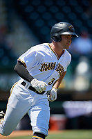 Bradenton Marauders third baseman Daniel Arribas (30) runs to first base during a game against the Charlotte Stone Crabs on April 9, 2017 at LECOM Park in Bradenton, Florida.  Bradenton defeated Charlotte 5-0.  (Mike Janes/Four Seam Images)