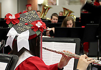 Farmington senior Ilya Bruce was one of many graduates who decorated their mortar boards for the 2019 commencement service. Bruce is playing flute with the Farmington High Band for one last time before taking her place in the processional.