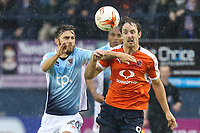 Macauley Wilson of Blackpool and Danny Hylton of Luton Town  battle for the ball during the Sky Bet League 2 Play Off Semi Final 2 leg match between Luton Town and Blackpool at Kenilworth Road, Luton, England on 18 May 2017. Photo by David Horn.