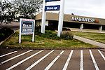 New Frontier Bank.  People and places impacted by the New Frontier Bank being placed into receivership by the State of Colorado.  The Greeley, Colo. bank was forced from business after making a series of bad loans.  Many eastern Colorado farms and business were impacted by the closing of the bank and are unable to transfer their loans to other institutions.  The fallout threatens commercial institutions that have historically relied on the bank for short-term credit...***..Tina Gasner, owner of Meme's Brick Oven Pizza, faces financial ruin because the small business loan she had from New Frontier Bank fell through.  She works three jobs to support her startup and is unable to find new financing...John Vazquez, mayor of the Town of Windsor, had a land acquisition/development loan with New Frontier Bank as well as a credit line to run his small engineering firm.  After the bank's failure, Vazquez laid off his employees and closed his business.  Pictured here, he is helping put the final touches on the reconstruction of the town's park that was destroyed by a tornado at this time last year...***..Miscellaneous portraits of the bank building, agricultural elevators, and vacant commercial real estate in and around Greeley, Colo.