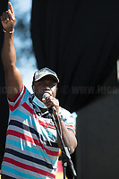 """Braccianti's Representative.<br /> <br /> Rome, 05/07/2020. Today, thousands of people gathered in Piazza San Giovanni to attend the """"Stati Popolari"""". The rally, organised by Aboubakar Soumahoro (1.) - Trade Union Coordinator of the Unione Sindacale di Base USB, was meant to be a popular answer by the """"Invisibles"""" to the """"Stati Generali dell'Economia"""" (States General of the Economy, 2.) of the Italian Prime Minister Giuseppe Conte, a 10-day-long meeting held in June at Villa Doria Pamphili (Villa Doria Pamphilj, 2.) where Italian and EU leaders / members of Governments, bankers, investors, advisors, met to discuss the economic recovery from the Covid-19 / Coronavirus crisis. From the organisers Facebook event page: «The Popular States will be our agora, where different realities will bring their pains and their proposals. A human square to make all the invisible visible and to give voice to all the unheard, our only symbol. The Popular States will be the communion of our needs and our struggles […]» (3.). At the end of the demo Soumahoro, who mainly deals with protection of """"Braccianti"""" (agricultural workers) rights, fights against """"caporalato"""" (illegal hiring) and the exploitation along the agricultural supply chain, gave a speech (4.) addressing the requests to the Government: - National plan for the work emergency; - Public housing program; - integral reform of the food supply chain; - radical transformation of migration policies (including, the """"right to return"""" for Italian migrants); - abolish the """"Security decrees"""" and cancel Bossi-Fini law; - reform the reception; - ecological transition strategy; - proactive interventions against discrimination and for equality.<br /> <br /> Footnotes & Links:<br /> 1. (Wikipedia.org) http://bit.do/fF4rH<br /> 2. 16.06.20 Aboubakar Soumahoro: Hunger/Thirst Strike And Meeting With Italian Prime Minister Conte http://bit.do/fGrbH<br /> 3. http://bit.do/fGrbD & https://www.facebook.com/StatiPopolari/<br /> 4. Aboubakar Soumahor"""