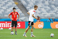 Germany manager Joachim Low watches Thomas Muller of Germany