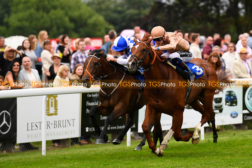 Winner of The CPA Scaffolding Maiden Stakes, Robin Weathers (gold cap) ridden by Daniel Muscutt and trained by William Haggas   during Ladies Evening Racing at Salisbury Racecourse on 15th July 2017