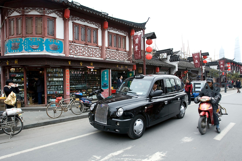 A 'Black cab', famous in London, is parked in Shanghai's old town neighborhood, in Shanghai, China, on March 23, 2009.  London Taxi International, the producer of London Taxi's famed black cabs, turned to China to drive overseas expansion. More than 8,000 London Taxis will be produced from the Chinese factory, more than double the annual output of the firm's historical factory plant in Conventry, England. Most of these cars will go to places like Singapore, Dubai, Moscow, that covet the image associated with the London Taxis' tradition of good service and durability. London Taxi International will continue to build 90 percent of the Taxi cabs used in Britain at Coventry. Photo by Lucas Schifres/Pictobank