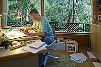 Dennis McGuire in his home office on Cedar Glen in Pine Cove