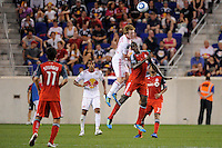 Dax McCarty (11) of the New York Red Bulls and Tony Tchani (32) of Toronto FC go up fora header. The New York Red Bulls defeated Toronto FC 5-0 during a Major League Soccer (MLS) match at Red Bull Arena in Harrison, NJ, on July 06, 2011.