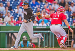 19 September 2015: Miami Marlins outfielder Christian Yelich comes home to score against the Washington Nationals just beating out the throw to catcher Wilson Ramos at Nationals Park in Washington, DC. The Marlins fell to the Nationals 5-2 in the third game of their 4-game series. Mandatory Credit: Ed Wolfstein Photo *** RAW (NEF) Image File Available ***