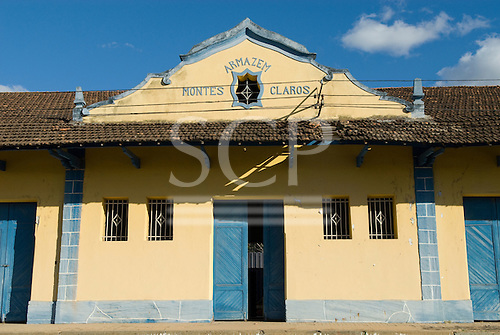 Montes Claros, Minas Gerais, Brazil. Colonial warehouse painted yellow and blue.