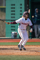 Saige Jenco (18) of the Virginia Tech Hokies follows through on his swing against the Toledo Rockets at The Ripken Experience on February 28, 2015 in Myrtle Beach, South Carolina.  The Hokies defeated the Rockets 1-0 in 10 innings.  (Brian Westerholt/Four Seam Images)