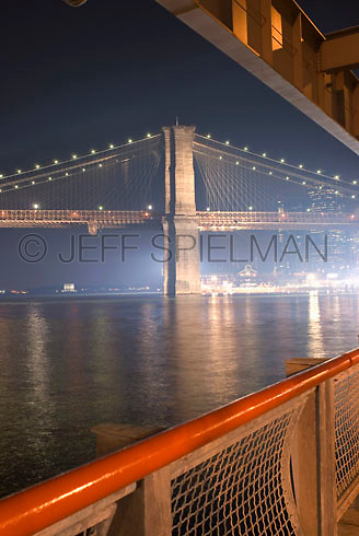 Brooklyn Bridge and East River Illuminated at Night, Viewed from East River Esplanade in Lower Manhattan....THIS IMAGE IS AVAILABLE EXCLUSIVELY FROM GETTY IMAGES.....PLEASE SEARCH FOR IMAGE # 200527591-001 ON WWW.GETTYIMAGES.COM..