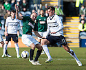 Hib's Dylan McGeouch and Raith Rovers' Ross Callachan challenge for the ball.