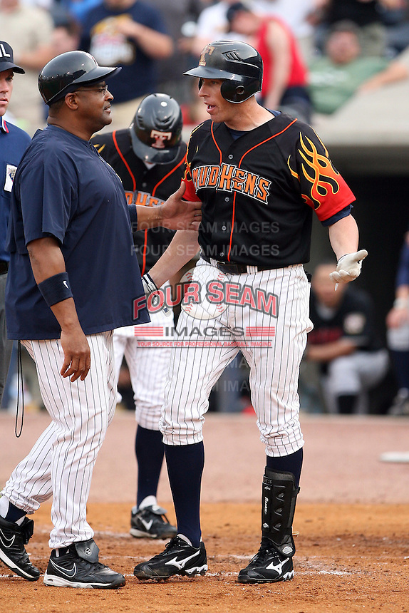 "June 12th 2008:  Mike Hessman of the Toledo Mudhens, Class-AAA affiliate of the Detroit Tigers, is restrained by Leon ""Bull"" Durham during a game at Fifth Third Field in Toledo, OH.  Photo by:  Mike Janes/Four Seam Images"