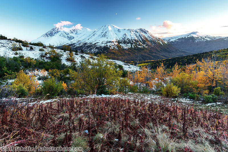 Fall landscape of early snow on Chugach Mountains in Arctic Valley area of Anchorage, Alaska with alpenglow  September 2015