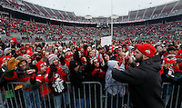 Ohio State Buckeyes offensive lineman Taylor Decker high fives fans during the celebration for winning the national championship at Ohio Stadium on Jan. 24, 2015. More than 40,000 fans attended the celebration. (Adam Cairns / The Columbus Dispatch)