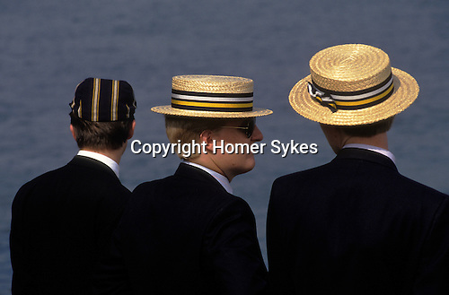 Henely on Thames regatta week. Oxfordshire UK. Men wearing his rowing club colours colors.